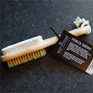 Body Systems Pumice Brush is double sided for exfoliating different areas of the feet.